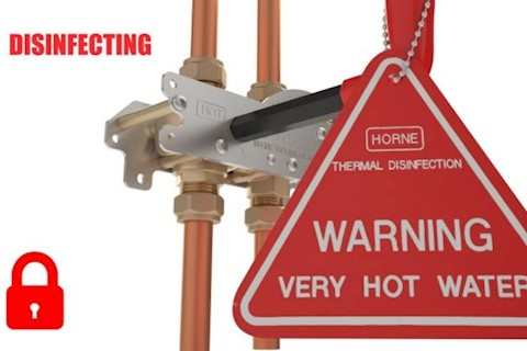 Horne ILTDU operation key with hot water warning sign