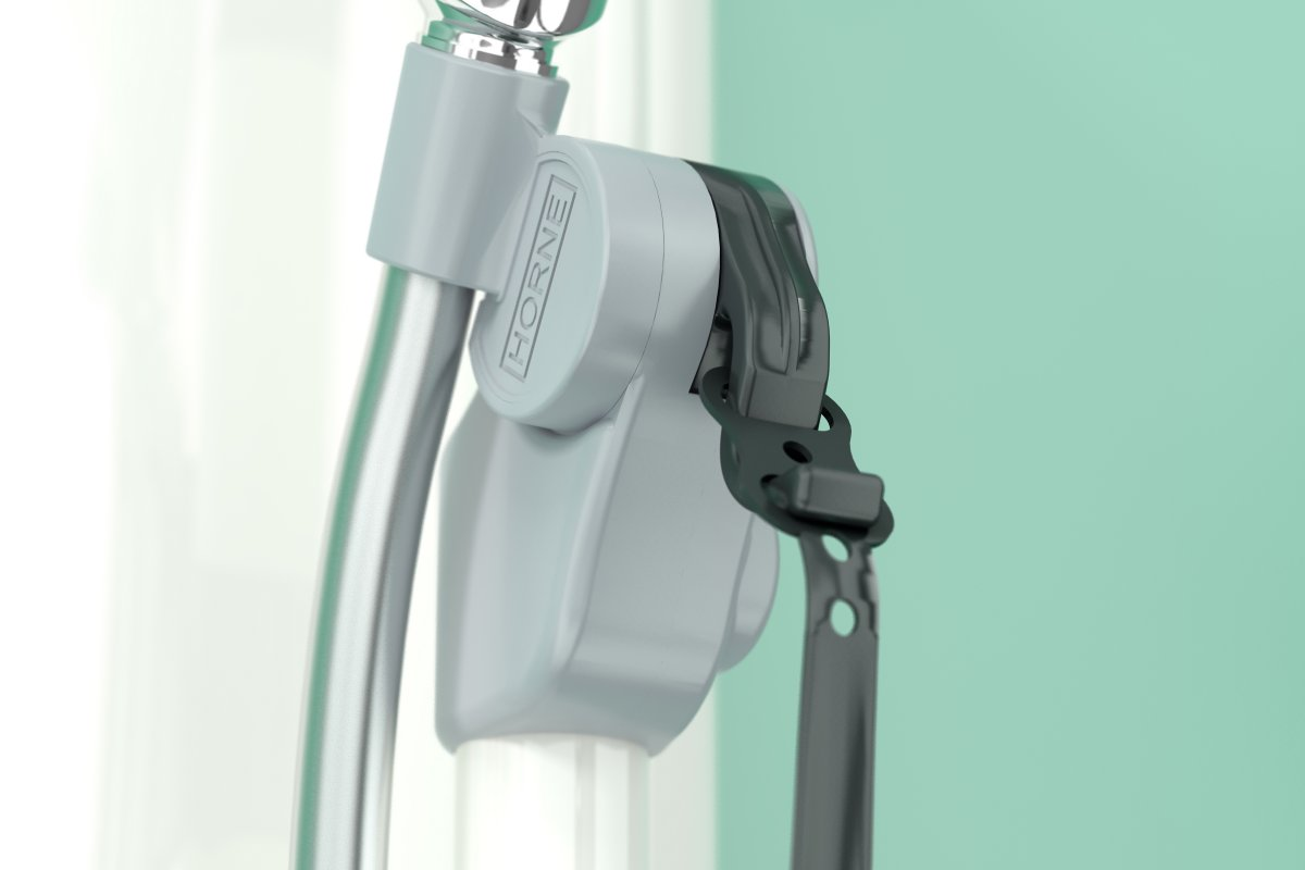 Horne shower handset riser adjustment release mechanism